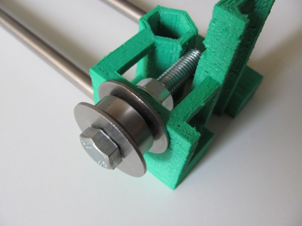 Close-up of the x-idler bearing over which the x-axis timing belt is mounted.